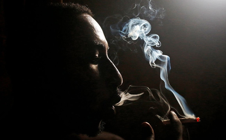 Profile picture of a man smoking a joint